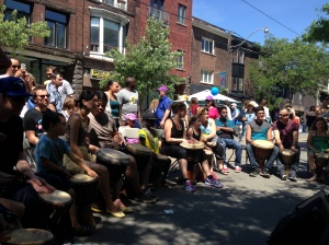 The public joining in on MusiCamp's African Drum workshop at The Dundas West Festival 2016.